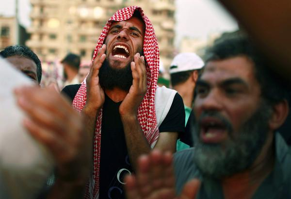 A supporter of the Muslim Brotherhood shouts during a sit-in protest against the military council at Tahrir Square in Cairo.