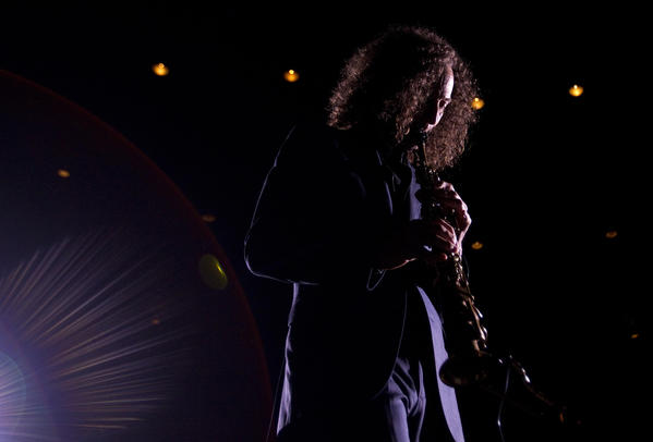 Kenny G plays the soprano saxophone in the middle of the crowd during the second evening of the Hampton Jazz Festival at Hampton Coliseum on Saturday.