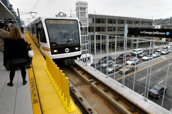 A train on Metro's Expo Line arrives at the platform of the new La Cienega/Jefferson station.