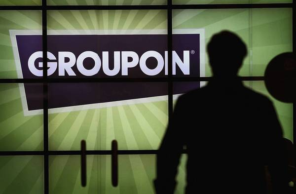 The Groupon logo is displayed in the lobby of the company's international headquarters.