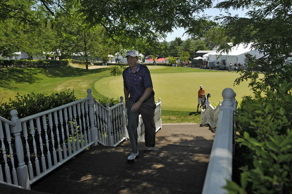 Fairfield's J.J. Henry makes his way to the first tee Sunday. Henry, at 5-under, is 7 shots behind the leaders.