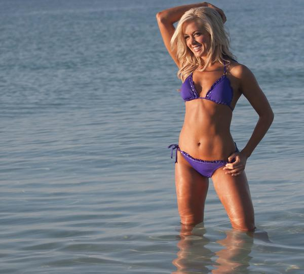 Cheerleader Catherine C. models a bikini at the Ravens cheerleader calendar shoot in the Bahamas.
