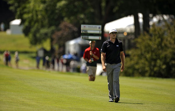 Hunter Mahan walks up the 18th fairway in the hunt for a final round record during the 2012 Travelers Championship golf tournament at the TPC River Highlands in Cromwell Sunday Morning. Mahan tied the record with a -9, 61.