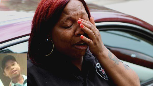 Sandra Tyler tears up as she describes holding her son as he lay dying on the street. Thirteen year-old Tyquan Tyler (inset) was shot and killed on the street after a fight broke out at a party at 6200 block of South Rhodes Avenue. Tyler was trying to leave with his two sisters and struck by a bullet shot from a car driving by. (Chuck Berman/Chicago Tribune)