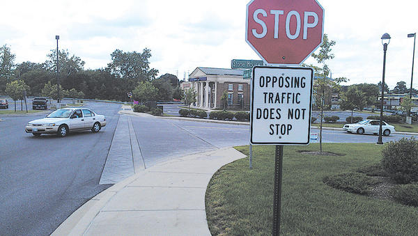 "Signs at Stone House Square that say ""opposing traffic does not stop"" are mistaken. They are supposed to refer to traffic entering the shopping center, not opposing traffic."