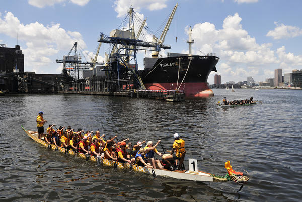 The Pittsburgh Dragon Boat Associaiton Youth team paddles back from the finish line at the Tide Point Marina in Baltimore.