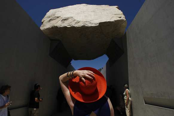 "Alisa Katz seems amazed with artist Michael Heizer's ""Levitated Mass,"" which opened to the public at the Los Angeles County Museum of Art on June 24, 2012."