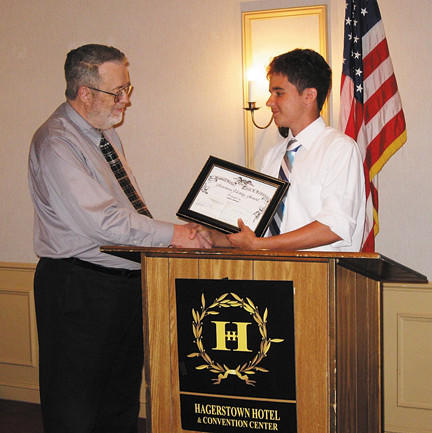 Dimitri Wolford, right, received a $1,500 scholarship from the Hagerstown Civil War Round Table at its May 24 meeting. John Munday, chairman of the Round Table scholarship committee, is at left.