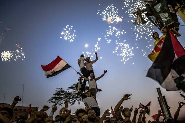 Egyptians celebrate the election of Mohamed Morsi in Tahrir Square in Cairo.
