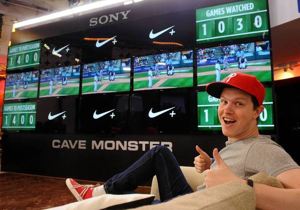Bethlehem native Gordon Mack gives a thumbs up while watching the St. Louis Cardinals vs. Detroit Tigers game Thursday afternoon at the Major League Baseball Fan Cave.