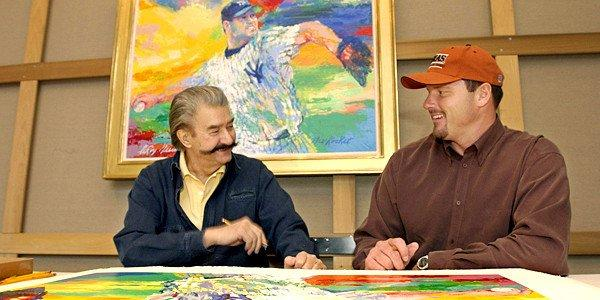"On Nov. 13, 2003, New York Yankees pitcher Roger Clemens, right, talks to artist Leroy Neiman about baseball while signing limited-edition serigraphs based on Neiman's painting ""The Rocket,"" above, of Clemens on the mound in pinstripes, at Neiman's New York studio."