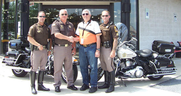From left, Cpl. Paul Colantuno; Frederick County (Md.) Sheriff Chuck Jenkins; Michael Vantucci, owner of Harley-Davidson of Frederick; and Sgt. David Hunter stand outside Harley-Davidson of Frederick, which recently donated two motorcycles to the Frederick County Sheriff's Office.