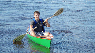 Central Lake High School student Ryan Prate takes a canoe that he and other area high-school students recently built for a short ride Friday in Petoskeys harbor. The canoe and a near-identical one were built as part of a semester-long pilot program offered by the Michigan School of Boat Building and Marine Technology and Charlevoix-Emmet Intermediate School District.