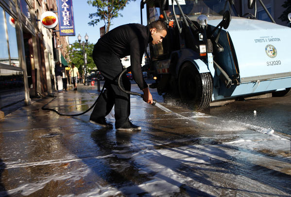Frankie Aguirre cleans the sidewalk in front of Ann Sather restaurant at Belmont Avenue and Clark Street Monday morning.