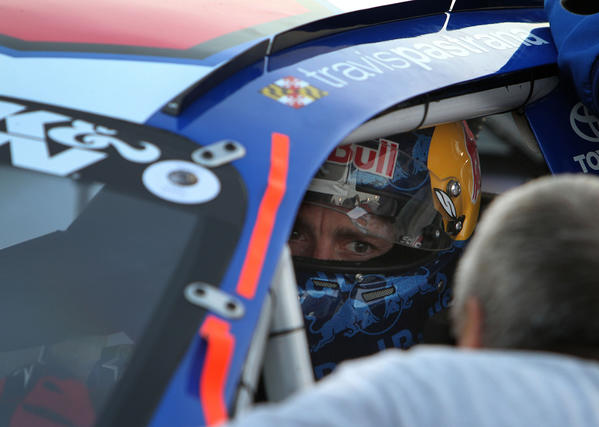 Travis Pastrana gets last minute instructions before the K&N Pro Series East race Saturday evening at Langley Speedway.