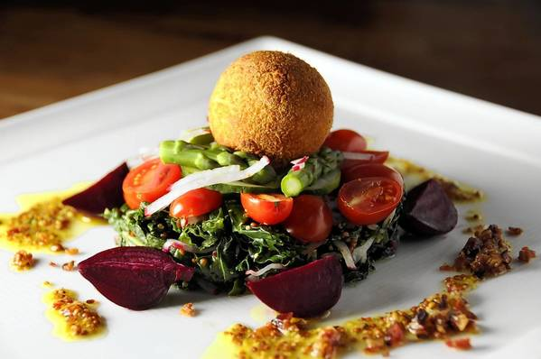 The Market Salad, created at the Firebox Restaurant in Hartford, is made with kale, roasted heirloom beets, grape tomatoes, Easter egg radish, bacon, whole-grain mustard and Beltane Farm crispy goat cheese.