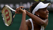 Venus Williams, a five-time Wimbledon champion, lost in the first round Monday to Elena Vesnina of Russia, 6-1, 6-3.