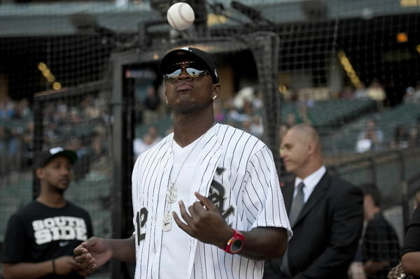 Singer/producer Ne-Yo tosses a baseball before throwing out a ceremonial first pitch at U.S. Cellular Field before a game between the White Sox and the Milwaukee Brewers on June 22.