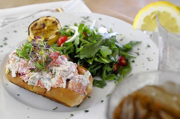 Listed on both its dinner and lunch menu is the Falls Village Inn's famous fresh Maine lobster roll.