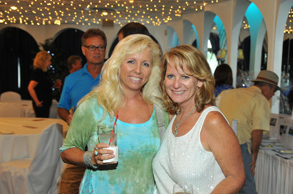 "Lisa Thornhill, left, and Wendy Poe at Deliver the Dream's second annual ""Fishing for the Dream"" family fishing tournament, which took place at the Lighthouse Point Yacht & Racquet Club."