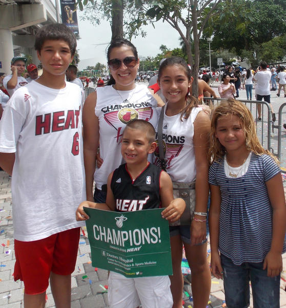 Fans braved the scorching temps outside to attend the championship parade held Monday in Downtown Miami.