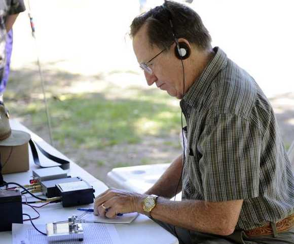 Bob Einem takes down a radio message on a 1.7 watt radio during the 24 hour event held by the Crescenta Valley Radio Club of Glendale at Verdugo Park on Sunday, June 23.