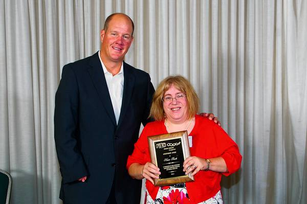 Karen Frisch of Coplay has been named the 2012 recipient of the Nettie Mann Achievement Award. She stants next to former professional baseball player and U.S. Olympian Jim Abbott at the Pennsylvania Industries for the Blind and Handicapped's Nettie Mann Achievement Awards Dinner.