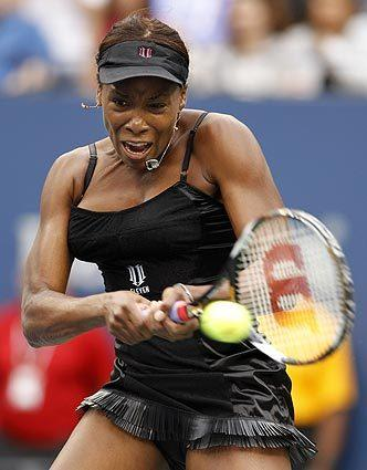 Venus Williams returns the ball to Kim Clijsters of Belgium during the U.S. Open in New York in 2010.