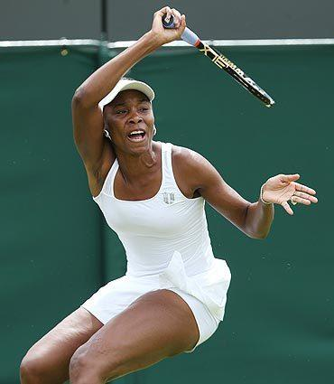 Venus Williams takes on Elena Vesnina of Russia at Wimbledon on Monday.