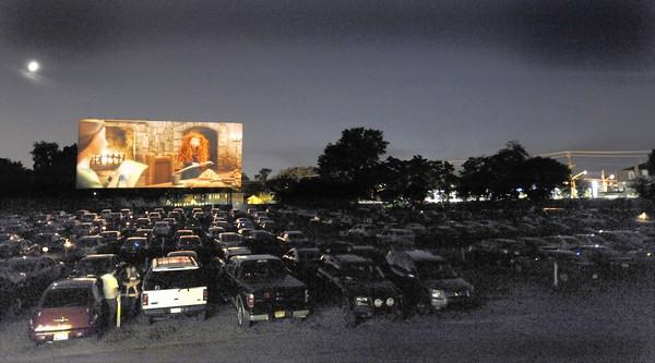 "A scene from ""Brave"" appears on-screen at the Bengies Drive-In Theatre in Middle River. At right is the Royal Farms Store."