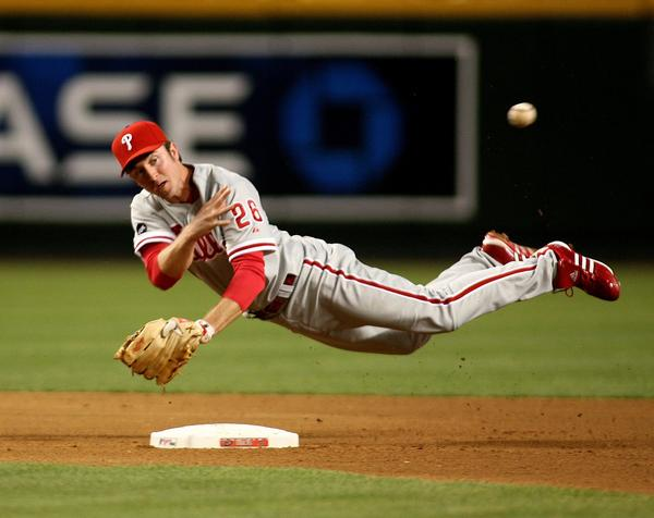 Philadelphia Phillies second baseman Chase Utley makes the off-balance throw  to first base on a ball hit by Arizona Diamondbacks' Orlando Hudson in the fourth inning during a National League baseball game on Tuesday, May 8, 2007, in Phoenix.