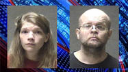 A mother and father were arrested and charged with neglect after police said their daughters were found malnourished after the parents took them on a cross-country road trip in pursuit of a television preacher.