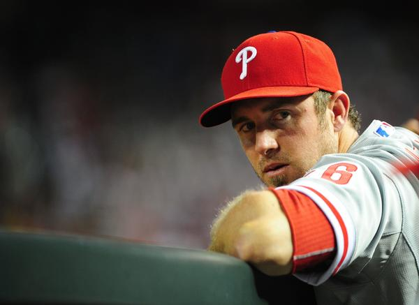 Philadelphia Phillies injured infielder Chase Utley in the dugout against the Arizona Diamondbacks at Chase Field.