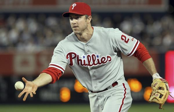 Chase Utley #26 of the Philadelphia Phillies flips the ball to first base for the final out of the eigth inning against the New York Yankees on June 17, 2010 at Yankee Stadium in the Bronx borough of New York City.