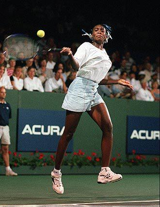 Venus Williams returns a shot to Steffi Graf in the Acura Classic Tennis tournament in Manhattan Beach in 1996.