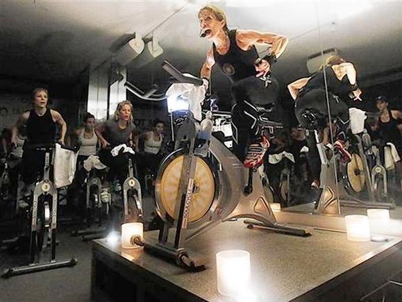 A fitness instructor leads a SoulCycle class at their Union Square location in New York