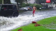 Man Pulled by SUV Wakeboards Down Flooded Street