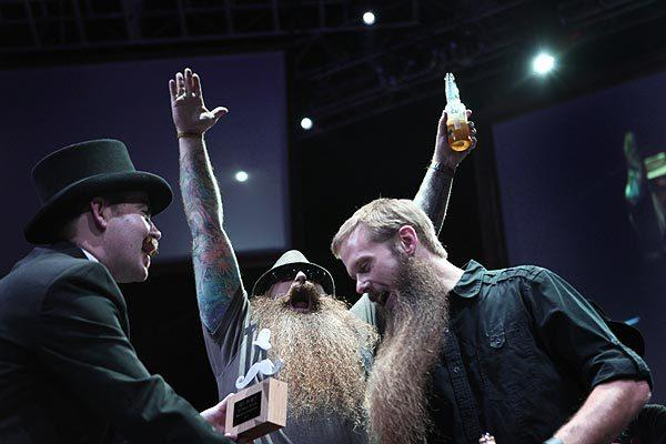 Ryan Dreyer celebrates his win as Scott Lehr receives a second-place trophy for the full beard natural category.
