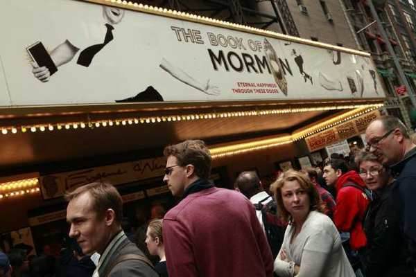 "Audiences wait outside the Eugene O'Neill Theatre in New York to see ""The Book of Mormon."""