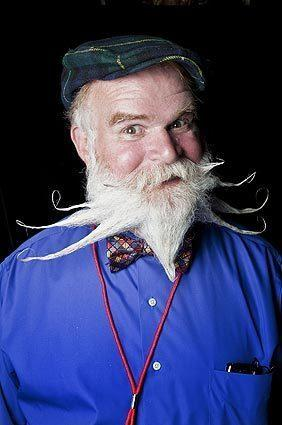 Jim Daly poses in the photo booth  during the second Los Angeles Beard and Mustache Competition in downtown Los Angeles on Sunday.