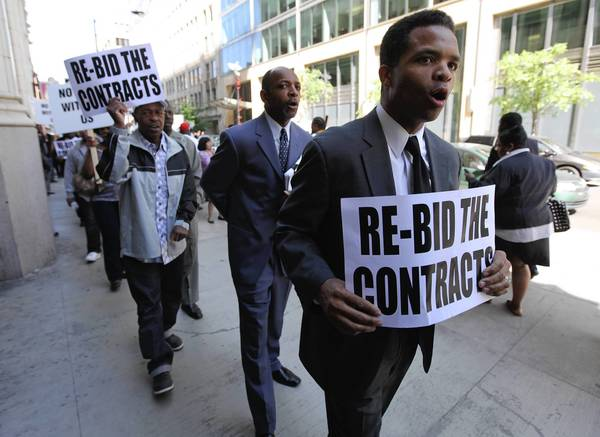 U.S. Rep. Jesse Jackson Jr. heads a rally for contracts outside the Metra headquarter.