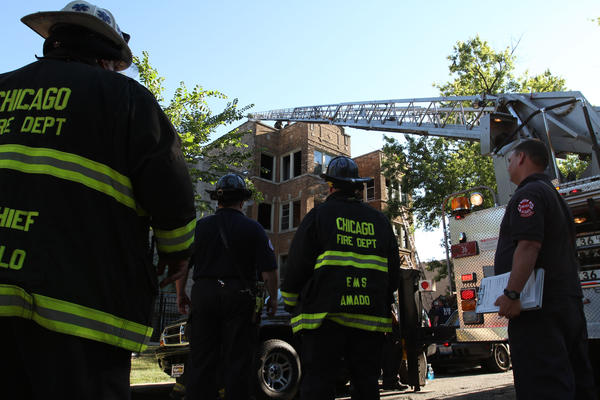 Firefighters at the scene of an apartment building building fire in the 3200 block of West Fulton Street this afternoon. Phil Velasquez Chicago Tribune