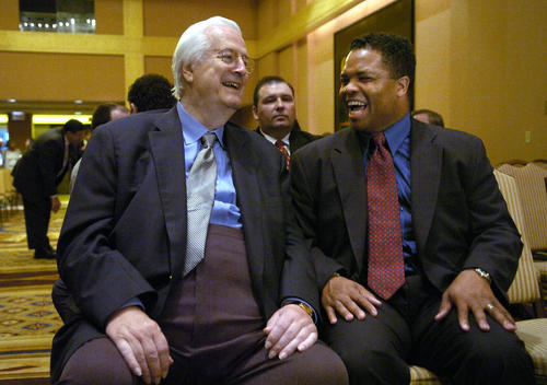 Reps. Henry Hyde and Jesse Jackson Jr. laugh during a meeting in September 2004 when a contract was signed to build a south suburban regional airport.