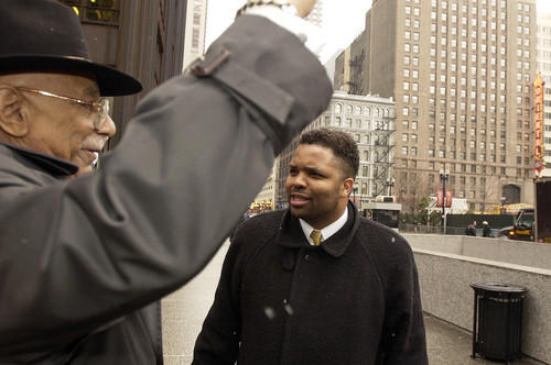 "Retired Justice Eugene Pincham raises his hand and says, ""Hallelujah,"" after Jesse Jackson Jr. informed  him about Trent Lott's resignation. The two met on the Daley Plaza after a news conference where Jackson commented on reports that Lott decided to withdraw as U.S. Senate majority leader."