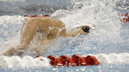 OMAHA, Neb. — Conor Dwyer pulled himself out of the water, walked across the pool deck at CenturyLink Center on Monday night and autographed the red British phone booth being used as a symbolic prop at the U.S. Olympic swimming trials.