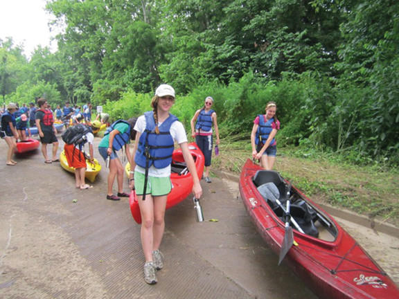 Some of the 100-plus students from 20 high schools from around the country load canoes and kayaks for their 10-mile paddle down the Potomac River from the the U.S. Fish and Wildlife Services National Conservation Training Center boat ramp to the Shepherdstown, W.Va., boat ramp Monday morning.