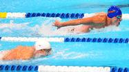 OMAHA, Neb. — Michael Phelps finished second in the 400-meter individual medley to archrival Ryan Lochte in the opening act of the Olympic swimming trials Monday, but both qualified for the London Games, setting the stage for another duel in their sport's most challenging event.