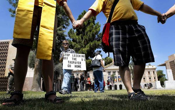 People demonstrate at the Arizona Capitol in Phoenix on Monday.