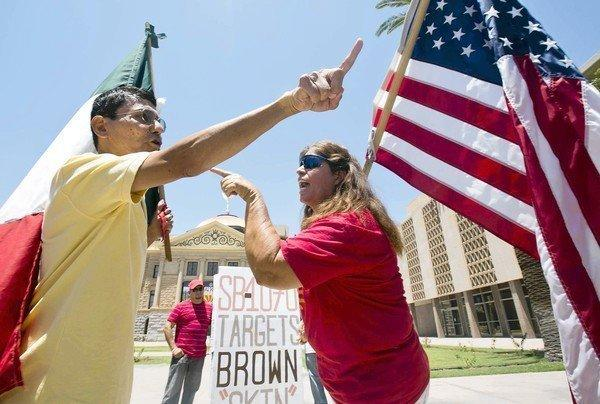 Protesters disagree about the Arizona immigration law outside the state Capitol in Phoenix on Monday.