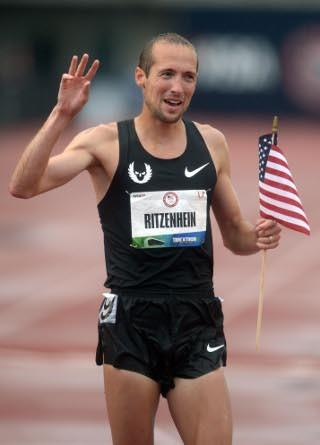Dathan Ritzenhein celebrates making the 2012 U.S. Olympic team in the 10,000 meters. (Kirby Lee - US Presswire)
